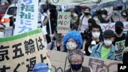 9일 일본 도쿄 국립경기장 주변에서 7월 올림픽 개최에 반대하는 집회가 열렸다.