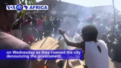 VOA60 Africa - Clashes Erupt as Zimbabwe Election Results Delayed