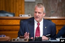 FILE - Sen. Dan Sullivan, R-Alaska, testifies during a hearing on Capitol Hill in Washington, May 7, 2020.