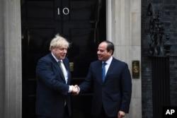 FILE - Britain's Prime Minister Boris Johnson, left, welcomes Egypt's President Abdel Fattah el-Sissi at 10 Downing Street, in London, Jan. 21, 2020, for a bilateral meeting.