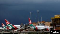 FILE - Kenya Airways planes are seen parked during a pilots strike organized by Kenya Airline Pilots Association (KALPA) at the Jomo Kenyatta International airport near Nairobi, Apr. 28, 2016.