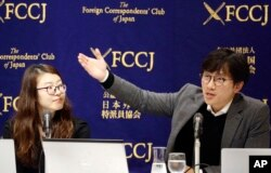 FILE - Plaintiffs' attorneys Lim Jae-sung, right, speaks as Kim Se-eun listens during a press conference in Tokyo, Dec. 4, 2018. Lawyers for South Koreans forced into wartime labor have taken legal steps to seize the South Korean assets of a Japanese company.