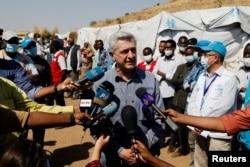 The United Nations High Commissioner for Refugees Filippo Grandi talks to the media during his visit to the Um Rakuba refugee camp on the Sudan-Ethiopia border, Sudan, Nov. 28, 2020.