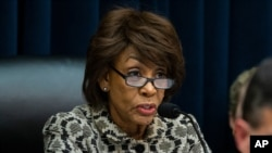 Chairwoman Maxine Waters, of Calif., speaks as Federal Reserve Chairman Jerome Powell testifies before the House Committee on Financial Services, on Capitol Hill, Tuesday, Feb.11, 2020 in Washington. (AP Photo/Alex Brandon)