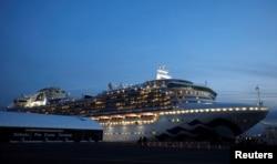 The cruise ship Diamond Princess, where more than 60 people have tested positive for coronavirus so far, is seen at Daikoku Pier Cruise Terminal in Yokohama, south of Tokyo, Feb. 7, 2020.