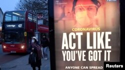 A public health information message is seen at a bus stop in West Ealing as the South African variant of the novel coronavirus is reported in parts of the United Kingdom amid the spread of the coronavirus, London, Britain, Feb. 1, 2021.