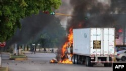 A truck burns in a street of Culiacan, Sinaloa state, Mexico, Oct. 17, 2019.