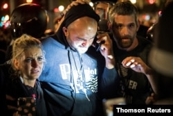 FILE - Joey Gibson, leader of the right wing Patriot Prayer group, arrives at the scene of a shooting amid weekend street clashes between supporters of President Donald Trump and counterdemonstrators in Portland, Oregon, Aug. 29, 2020.