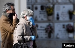 Relatives attend the funeral of a woman who died from coronavirus disease (COVID-19), as Italy struggles to contain the spread of coronavirus disease (COVID-19), in Seriate, March 28, 2020.