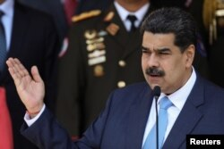 FILE - Venezuela's President Nicolas Maduro speaks during a news conference at Miraflores Palace in Caracas, March 12, 2020.