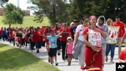 Miranda Muehl, of Mustang, Okla., marches during a march to call for justice for missing and murdered indigenous women Friday, June 14, 2019, at the Cheyenne and Arapaho Tribes of Oklahoma in Concho,…
