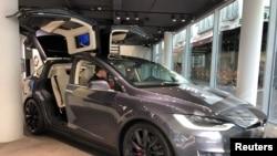 FILE - A Tesla Model X is on display at Telsa Inc's store in Frankfurt, Germany, Sept. 28, 2018.