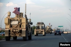 A convoy of U.S. vehicles is seen after withdrawing from northern Syria, in Erbil, Iraq, Oct. 21, 2019.