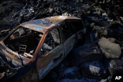 A vehicle was burned in a wildfire on the outskirts of Jerusalem, Aug. 17, 2021.