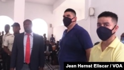 Mexicans Juan Jose Avila and Andres Vargas Flores in court as their sentence is read, July 15, 2020 in Les Cayes, Haiti. (Jean Hernst Eliscar / VOA)