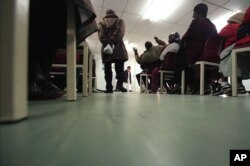 FILE - HIV-positive patients attend a class at the Princess Marina Hospital in Gaborone, Botswana, June 26, 2003.
