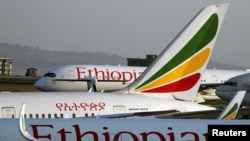 Grounded Ethiopian Airlines planes are seen in the airfield at the Bole International Airport amid concerns about the spread of coronavirus disease (COVID-19), in Addis Ababa, Ethiopia, April 7, 2020.