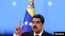 FILE - Venezuelan President Nicolas Maduro speaks during a news conference in Caracas, Dec. 8, 2020.
