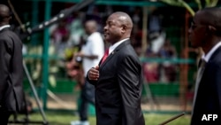 (FILES) In this file photo taken on July 01, 2015 Burundi's President Pierre Nkurunziza gestures as he arrives for celebrations of the country's 53rd Independence Anniversary at Prince Rwagasore Stadium in Bujumbura. - The Burundian president,…