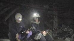 看天下: 波斯尼亚煤矿井下女矿工