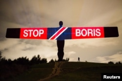 Anti-Brexit and anti-Boris Johnson messages are projected onto the Angel of the North sculpture in Gateshead, England, Sept. 3, 2019, in this picture obtained from social media on Sept. 4, 2019.