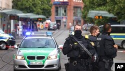 Police stand guard at the scene of a knife attack in Wuerzburg, Germany, June 25, 2021.