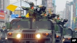 FILE - A fleet of Taiwanese military vehicles loading U.S.-made TOW anti-tank missiles rehearse for National Day celebrations in Taipei, Taiwan, Oct. 8, 2007.