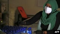 Sudanese workers prepare treat patients against the spread of the coronavirus COVID-19, on April 14, 2020 in Khartoum. Sudan's Ambassador to Uganda Najwa Abbas Gadaeldam was a victim of the virus. She died Wednesday in Khartoum.