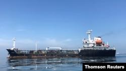 FILE - An oil tanker is seen in the sea outside the Puerto La Cruz oil refinery in Puerto La Cruz, Venezuela, July 19, 2018.