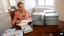 """FILE - Author Mary Higgins Clark signed copies of her book """"Daddy's Gone A Hunting"""" at the Simon & Schuster office in New York, April 3 2013.."""