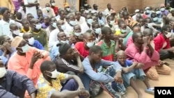 FILE - 40 of the 57 men who surrendered recently are former Boko Haram fighters, in Meri, Cameroon, July 29, 2021.(Moki Edwin Kindzeka/VOA)