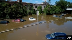 Cars and trucks are stranded by high water, Sept. 2, 2021, on the Major Deegan Expressway in Bronx borough of New York as high water left behind by Hurricane Ida still stands on the highway hours later.