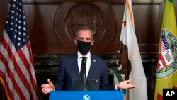 This still image taken from a live stream provided by Office of Mayor Eric Garcetti shows Los Angeles Mayor Garcetti wearing a protective face mask during his daily news conference in Los Angeles on April 1, 2020.