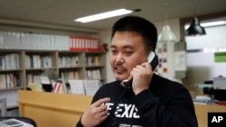 In this May 11, 2020 photo, Lee Jong-geol, general director of the gay rights advocacy group Chingusai talks on the phone before an interview in Seoul, South Korea. As South Korea grapples with a new spike in coronavirus infections thought to be…