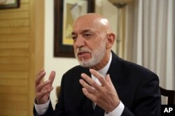 FILE - Former Afghan President Hamid Karzai speaks during an interview in Kabul, Afghanistan, Sept. 24, 2019.