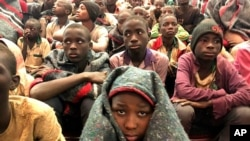 A group of schoolboys are pictured on Friday Dec. 18, 2020 in Katsina, Nigeria following their release after they were kidnapped earlier this week. More than 300 schoolboys kidnapped last week in an attack on their school in northwest Nigeria have…