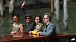 File - From Left: actors Ruth Negga, Brad Pitt, Liv Tyler and director James Gray arrive for the photo call of 'Ad Astra' at the Venice Film Festival, Aug. 29, 2019. The 77th Venice Film Festival will kick off on Sept. 2, 2020.
