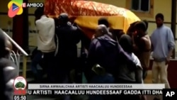 In this image taken from OBN video, the coffin of Ethiopia singer Hachalu Hundessa is carried during the funeral in Ambo, Ethiopia, Thursday July 2, 2020. More than 80 people have been killed in unrest in Ethiopia after the popular singer Hachalu…