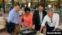 FILE - From left, the World Bank's Erik Bethel, Saint Lucia Gov. Nancy Charles, Taiwan Amb. to Saint Lucia Shen Cheng-tsung, and U.S. Department of State official Corey Johnston visit a U.S.-owned firm, in Saint Lucia, Nov 6. 2019. (@USEmbassyBbdos)