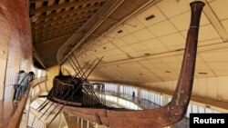 FILE - King Khufu's solar boat is displayed at a museum on the northern side of Khufu's Great Pyramid, in Giza, Egypt, Aug. 31, 2016.