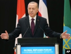 Predsednik Turske na tokom današnjeg obraćanja delegatima na Globalnom izbegličkom forumu u Ženevi (Foto: AP)