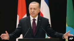 Turkey's President Recep Tayyip Erdogan delivers a speech during the Global Refugee Forum at the European headquarters of the United Nations in Geneva, Switzerland, Dec. 17, 2019.