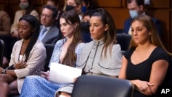 United States gymnasts from left, Simone Biles, McKayla Maroney, Aly Raisman and Maggie Nichols, arrive to testify during a Senate Judiciary hearing regarding the Larry Nassar investigation on Capitol Hill, Sept. 15, 2021.