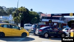 FILE - People queue up for takeaway food as the nationwide coronavirus disease (COVID-19) lockdown eases in Wellington, New Zealand, Sept. 1, 2021.