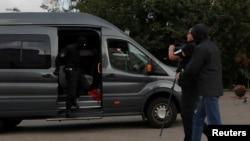 Law enforcement officers detain a journalist in central Minsk, Belarus, August 27, 2020.