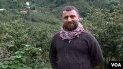Iskender started picking hazelnuts when he was 15, now 30 he runs a team of pickers, but regrets having to leave his home in Turkey's predominantly Kurdish region to work in the hazelnut fields. (D. Jones/VOA)