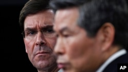 Defense Secretary Mark Esper, left, listens as South Korean National Defense Minister Jeong Kyeong-doo, right, speaks during a news conference at Pentagon in Washington, Monday, Feb. 24, 2020. (AP Photo/Susan Walsh)