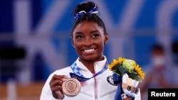 Bronze medalist Simone Biles of the United States celebrates on the podium, Aug.. 3, 20221.