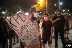 FILE - Demonstrators protests the shooting of Jacob Blake in Kenosha, Wisconsin, Aug. 26, 2020.