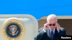 U.S. President Joe Biden steps off Air Force One at Cointrin airport as he arrives ahead of a meeting with Russian counterpart Vladimir Putin in Geneva, Switzerland, June 15, 2021.